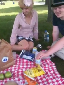 A couple enjoying a picnic lunch to go.